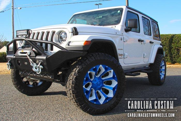 white jeep with blue tire accents